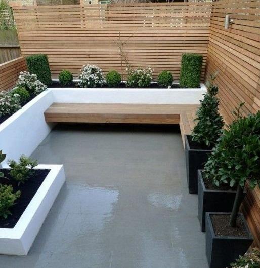 Reformez votre terrasse.  Terrasse rénovée en lattes de bois et béton ciré